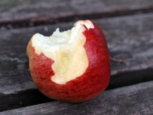 Image showing an apple that someone has started eating.