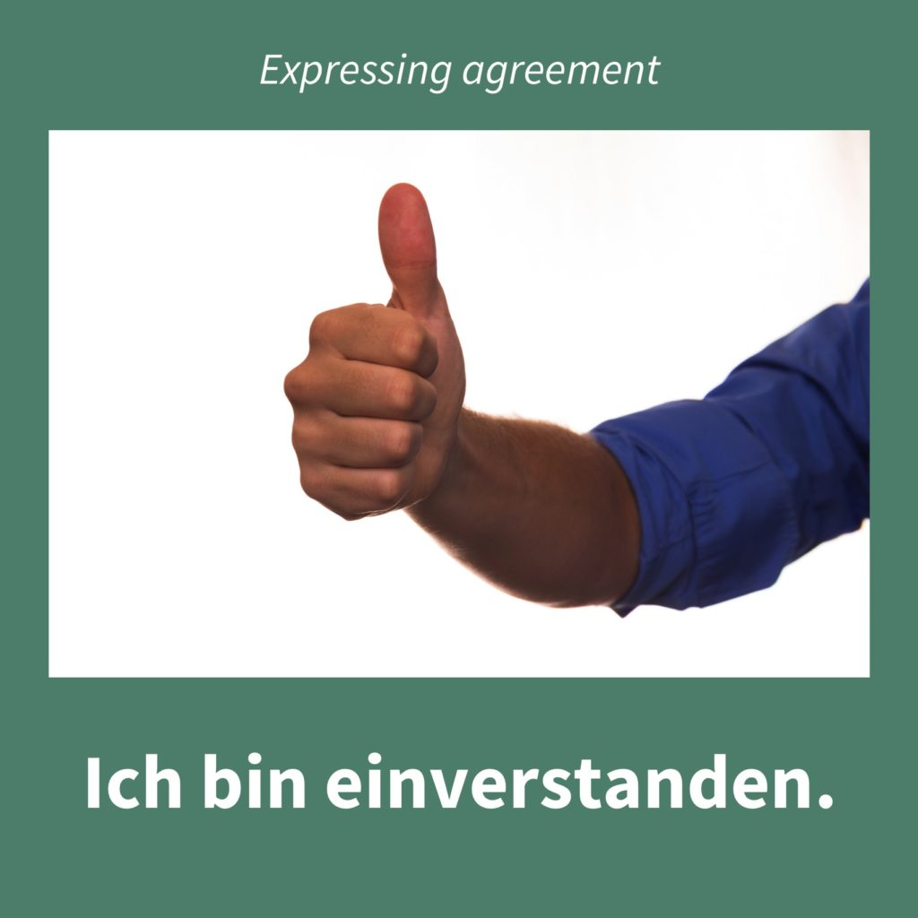 Image showing a thumb pointing upwards as a sign of expressing agreement with the caption in German: Ich bin einverstanden.