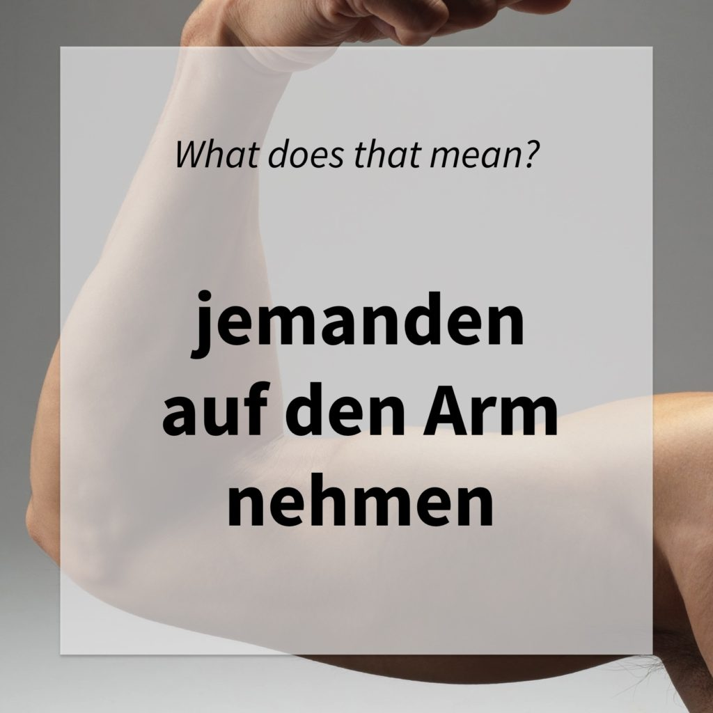 "Image of an arm and asking whether you know what ""jemanden auf den Arm nehmen"" means"