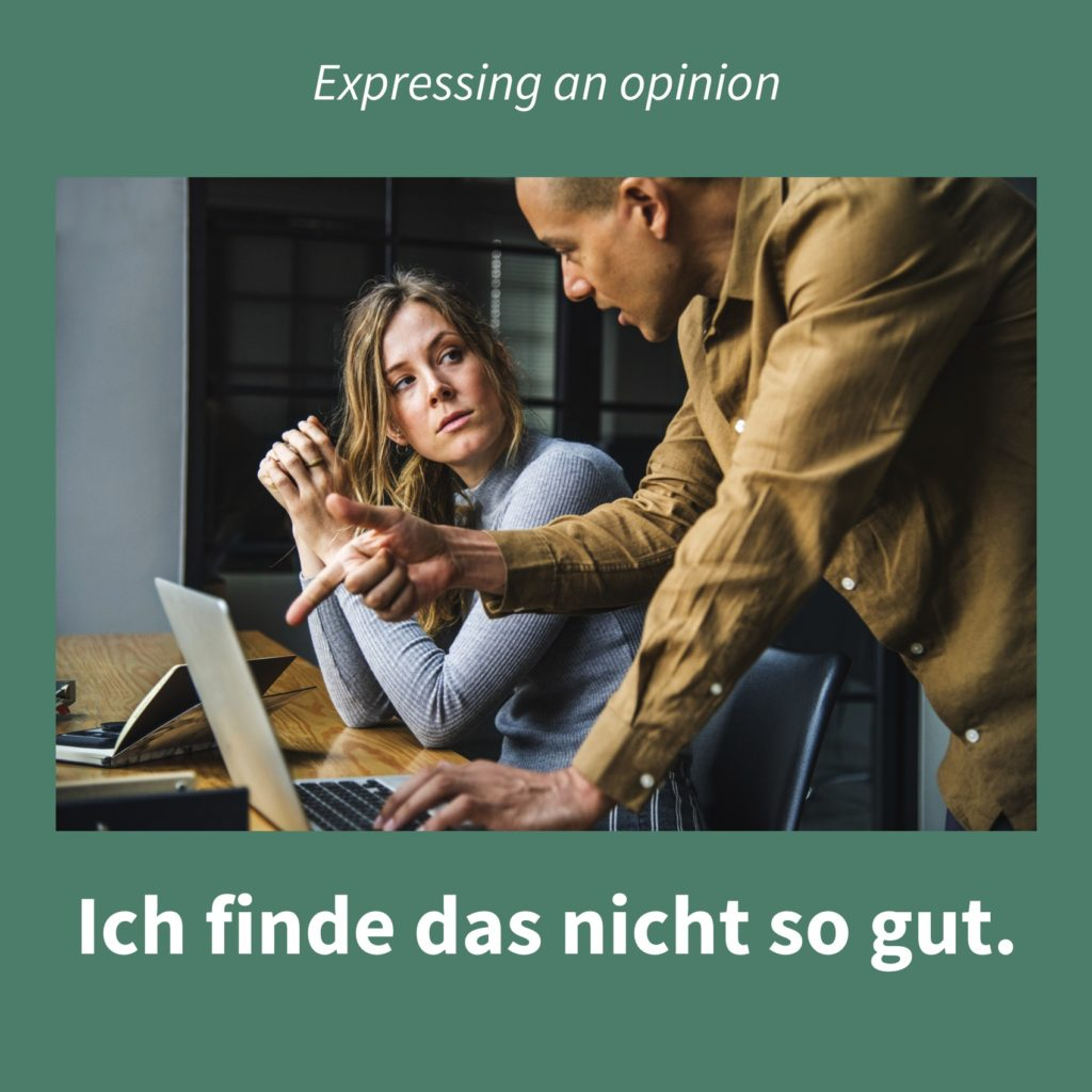 Image showing two people looking at a computer screen with the caption in German: Ich finde das nicht so gut.