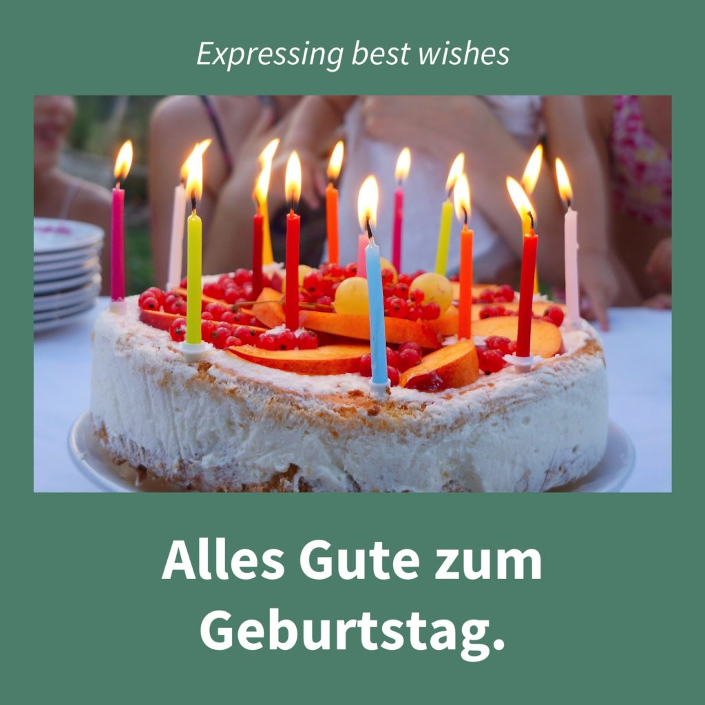 Image showing a cake with candles with the caption in German: Alles Gute zum Geburtstag.