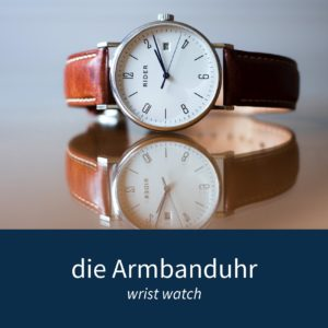"""Image showing a wrist watch and the German words """"die Armbanduhr"""""""