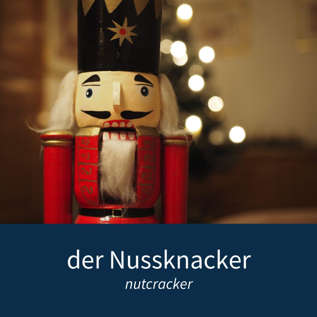 "Image showing a nutcracker figure and the caption ""der Nussknacker - nutcracker"""