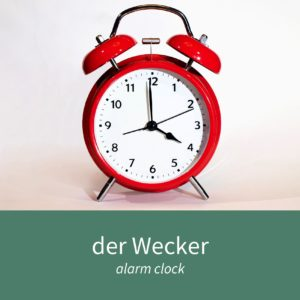 """Image showing an alarm clock and the caption """"der Wecker - alarm clock"""""""