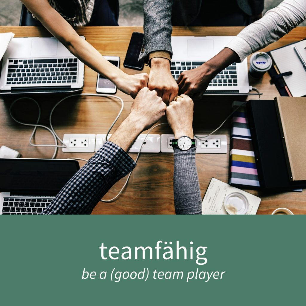 "Image showing five people working as a team and the caption ""teamfähig - be a (good) team player"""