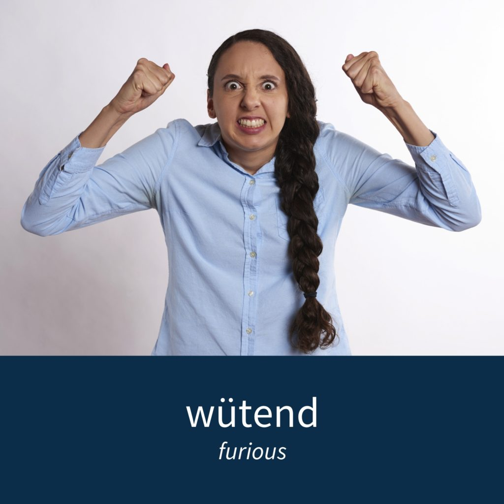 "Image showing furious person and the caption ""wütend - furious"""